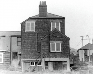 24. Herbert Street.  Big house on stilts. There was aboat repair yard near the Clydach River.  The Moose Hall was under the dock.