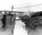 6.The Sack Factory. The canal went under the swing bridge, so tow path changed sides looking into Swansea.