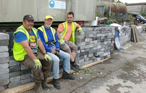 GORDON, GARETH AND MIKE TAKE A BREAK SITTING ON THE BLOCKS THEY HAVE RESUCUED FROM THE DEMOLISHED BUILDING.