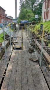 Sound timbers smiilar to these scaffoding planks will be floated down the canal saving transport costs and reusing a valuable resource.