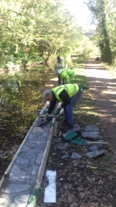 REINFORCING THE TOWPATH WALLS.