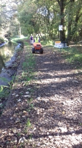 THE LONG HAUL DOWN THE TOWPATH. JOHN AT THE HELM OFF THE DUMPER TRUCK